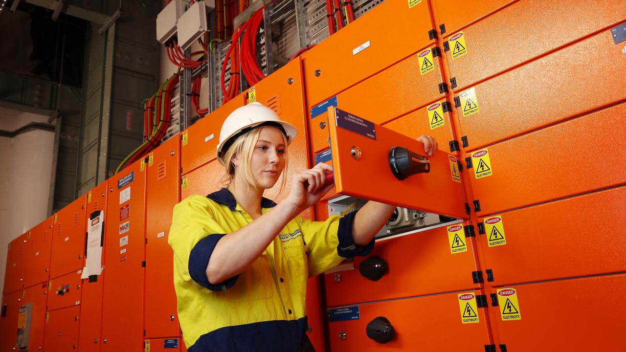 Electrical apprentice Brooke Willoughby at the Rail Operations Centre in Sydney is pleased she chose a trade and earns as she learns. Picture by John Feder.