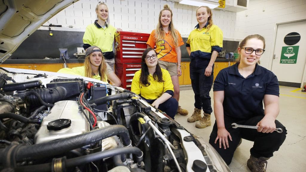 First-year apprentice brick layer Chelsea Whelan, second-year apprentice cabinet maker Charlotte Baily, third-year apprentice electrician Cordelia Nash, fourth-year apprentice carpenter Mel Ransley, fourth-year apprentice plumber Nikki Fischer and qualified light vehicle mechanic Ash Smith at TasTAFE Campbell Street, Hobart. Picture: Chris Kidd