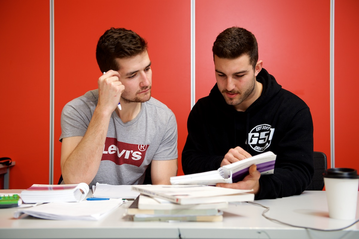 2 student apprentices studying